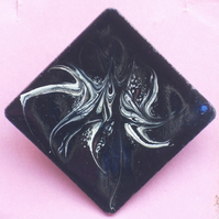 large square brooch - scrolled white on black