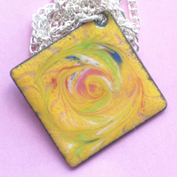 square pendant - scrolled  red green and blue over yellow