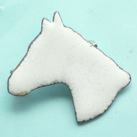 large white horsehead brooch