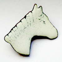 large horsehead brooch