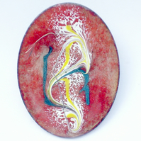 Enamel brooch - scrolled white, yellow, green over red
