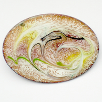 Enamel brooch - scrolled white, yellow, green and black over pale red-brown