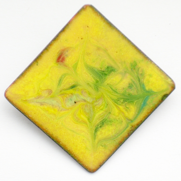 enamel brooch - square, scrolled green and red on yellow