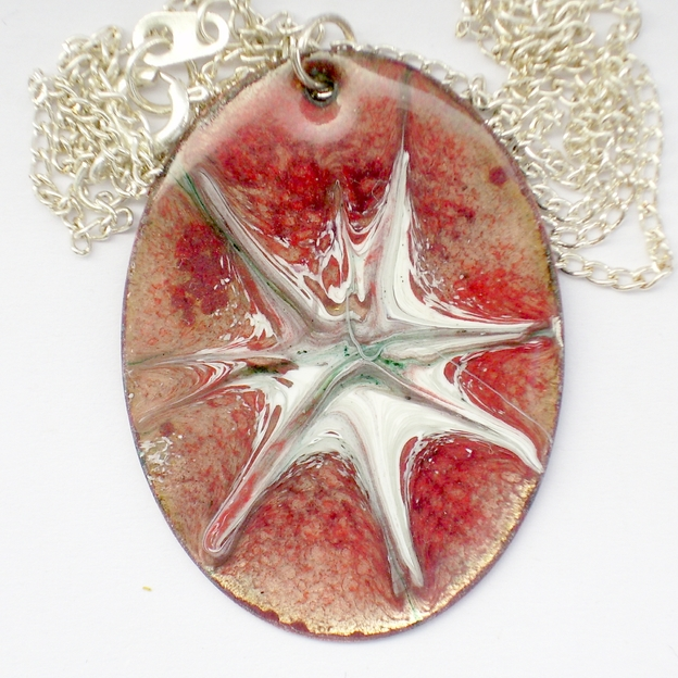 large oval pendant - scrolled white starburst over red
