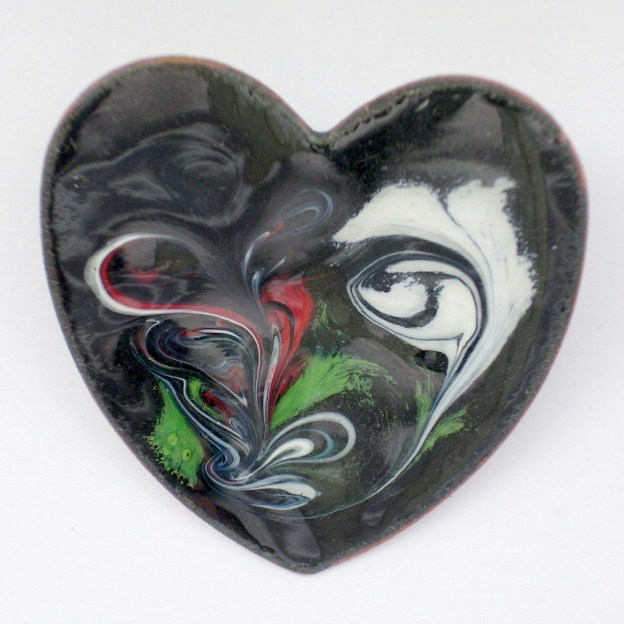 Heart shape brooch - scrolled white, red ,green on black