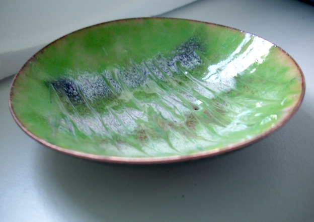 Enamel dish -scrolled brown, white and purple on green over clear enamel