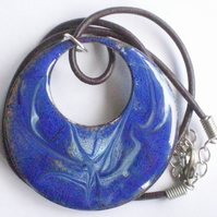 large pendant - pierced circle scrolled pale blue on dark blue over clear enamel