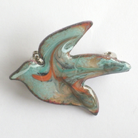 bird brooch - scrolled white, blue and orange over turquoise on clear enamel
