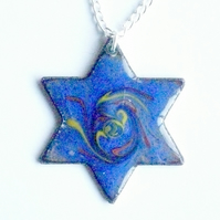 six point star scrolled orange and yellow on blue over clear enamel