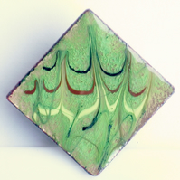 brooch - square: scrolled red-brown, gold, dark blue on green over clear enamel