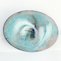 oval brooch - scrolled black and white over turquoise on clear enamel
