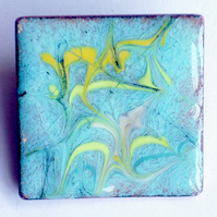 brooch - square: scrolled yellow and gold on turquoise over clear enamel