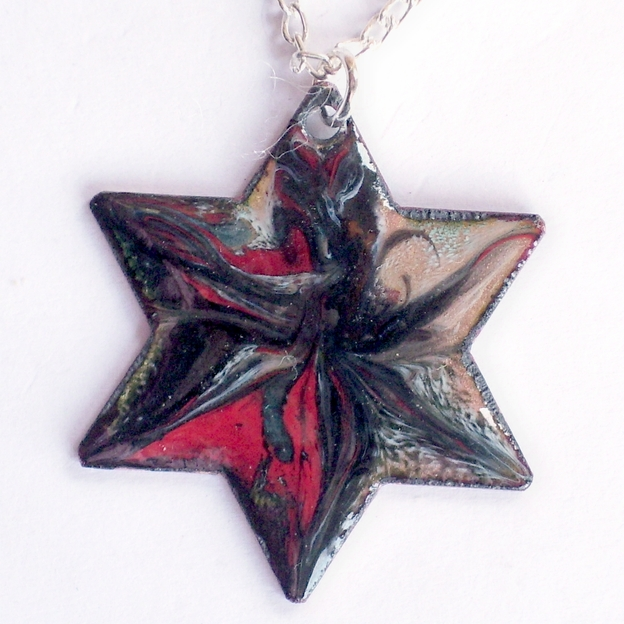 pendant - 6 pointed star scrolled black and red on clear enamel