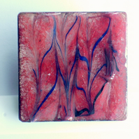 brooch - square: scrolled black and dark blue on red over clear enamel