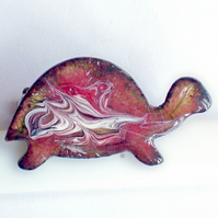 brooch - tortoise scrolled white on red over clear enamel