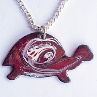 pendant - tortoise scrolled white on red over clear enamel
