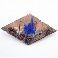 brooch - diamond shape scrolled blue and white over black and golden-brown