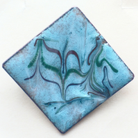 brooch -  square scrolled dark red, dark green, on turquoise over clear enamel
