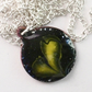 pendant - small round: scrolled yellow on black