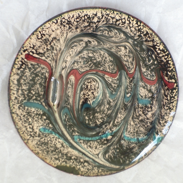 large round brooch - scrolled red and turquoise on black over clear enamel