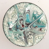 Brooch - round: scrolled turquoise and red-brown on white