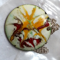 pendant - round: scrolled red and yellow on white