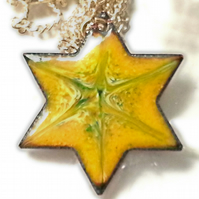pendant - 6 pointed star scrolled green and white on yellow over clear enamel