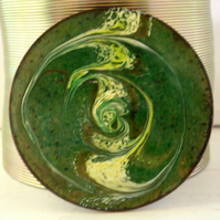brooch - round: scrolled white, gold and brown over green on clear enamel
