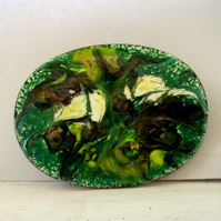 brooch - oval: scrolled brown, white and gold over green on white enamel