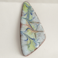 brooch: triangular - scrolled blue, orange, yellow, on pale blue over clear