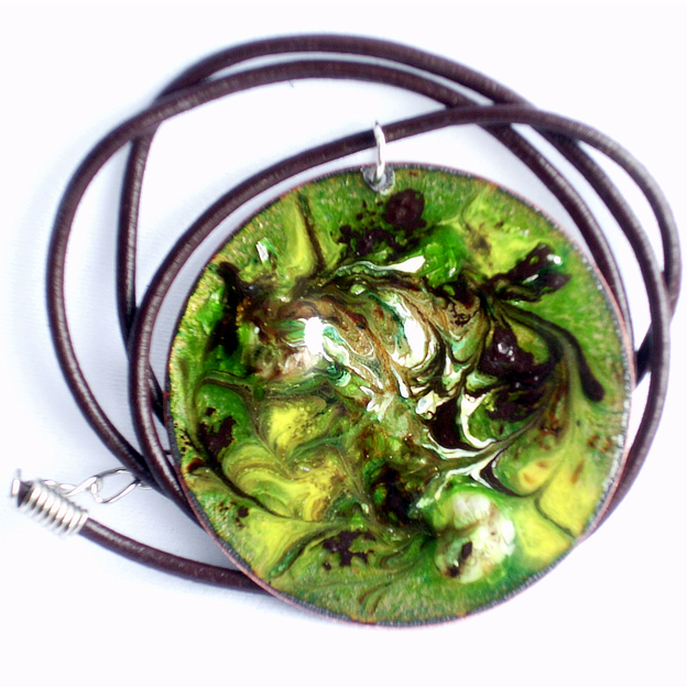 pendant: round - scrolled brown and white on green over clear