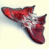brooch: butterfly - scrolled white and grey on red over clear enamel