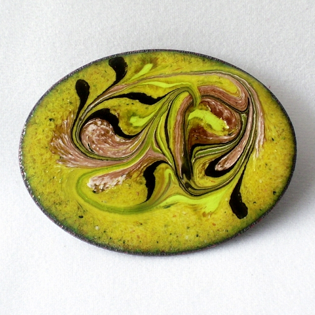 brooch - oval: scrolled black, pink, and white on yellow