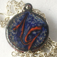 pendant: small round  scrolled red on blue over clear enamel