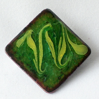 brooch - square, scrolled yellow on green over clear enamel