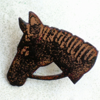 brooch - horsehead, black on clear enamel