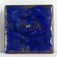 brooch: square, scrolled brick red on royal blue over clear enamel