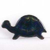 brooch - tortoise: scrolled gold on dark blue
