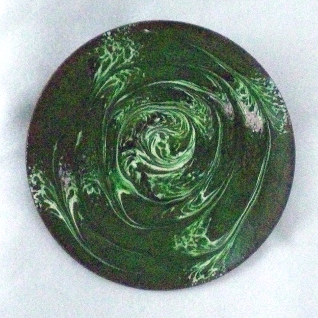 round brooch scrolled white and pink on green over clear enamel