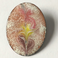 brooch - oval: scrolled yellow pink and purple over white on clear enamel