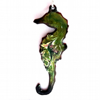 seahorse pendant - scrolled white and pink on green enamel over clear