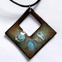 Pierced square pendant embellished with three beads