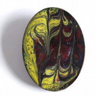 oval brooch scrolled yellow and maroon