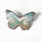 brooch: butterfly - scrolled pink and white over turquoise on clear enamel