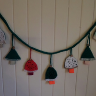 Christmas Bunting -  7 handmade Christmas trees hanging from a Crochet Tube