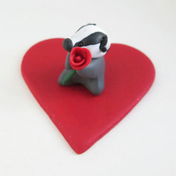 Tiny Valentine's Badger Ornament with a Single Red Rose on a Sparkly Red Heart