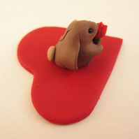 Tiny Valentine's Rabbit Ornament with a Single Red Rose on a Sparkly Red Heart