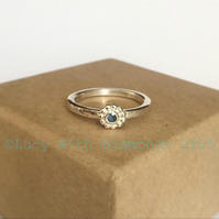 Sterling silver stacking ring with beaded setting and sapphire
