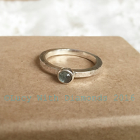 Sterling silver and cabochen blue topaz ring