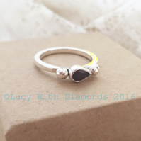 Sterling silver and pear shaped garnet ring